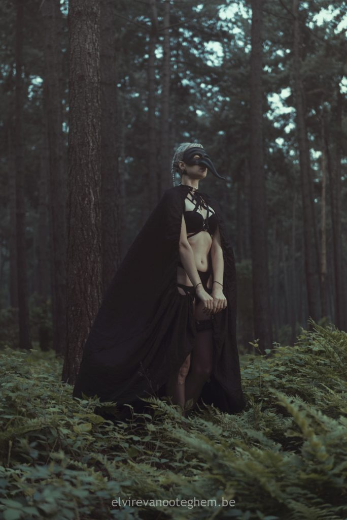 plague mask cape witch doctor forest